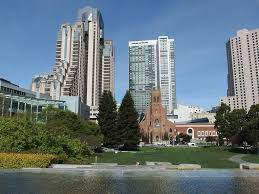 Yerba Buena Grdens, grassy lawn with SF buildings in background